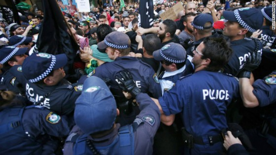 Protesters clash with police on a street in Sydney's central business district on Saturday, September 15, as part of widespread anger over a film ridiculing Islam's Prophet Mohammed.