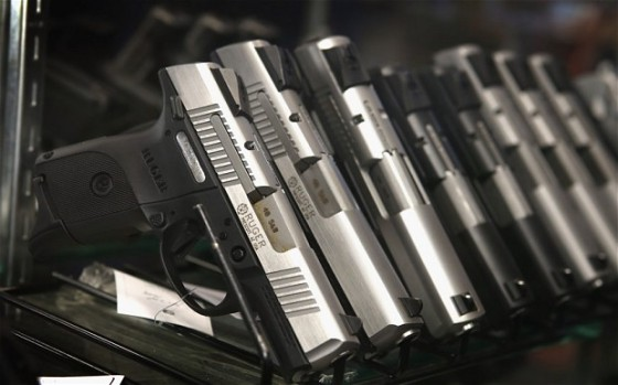 In October the number of background checks on people applying to buy guns, an indicator of future sales, increased by 18.4 per cent Photo: GETTY IMAGES