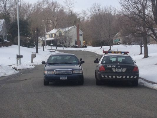 Photo credit: Sarah Armaghan   A marked Clarkstown police cruiser and an unmarked cruiser stop in front of Britta Lane in New City. (Jan. 17, 2013)
