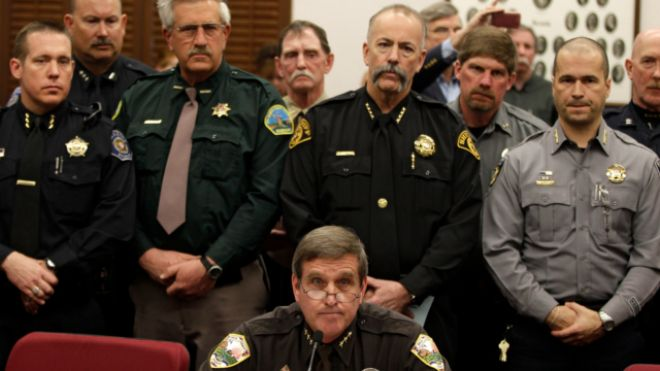 March 4, 2013: Weld County Sheriff John Cooke, center, backed by a group of fellow sheriffs, testifies against proposed gun control legislation in the Colorado Legislature, at the State Capitol, in Denver. (AP)   Read more: http://www.foxnews.com/politics/2013/03/17/colorado-sheriff-says-new-state-gun-laws-wont-be-enforced/#ixzz2NoMj1gpb