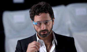 A Seattle bar has banned patrons from wearing the upcoming Google Glass wearable computers, worn here by Google co-founder Sergey Brin. (Seth Wenig/Associated Press)
